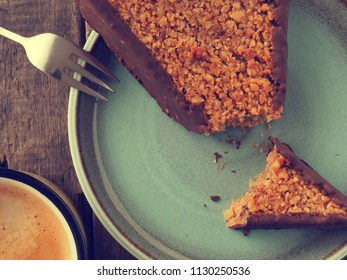 Tasty sweet organic cookies with a cup of coffee on a rustic wooden table