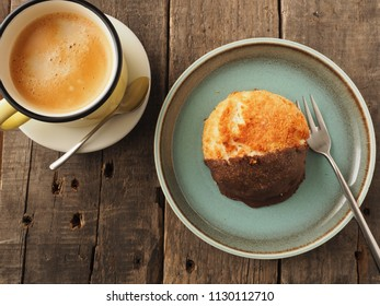 Tasty sweet organic macaroon with a cup of coffee on a rustic wooden table