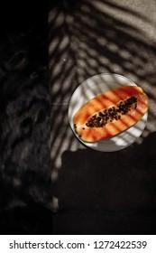 Tasty and sweet papaya. Raw breakfast. Exotic tropic fruit