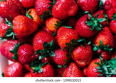 Tasty sweet strawberries freshly collected.  Ripe strawberries background, shot directly from above. Fresh berries for healthy breakfast, smoothie or Asai bawl