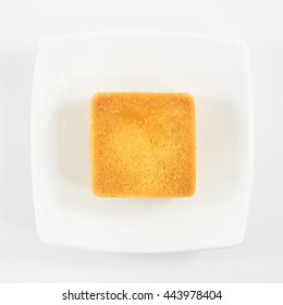 The tasty Taiwanese pineapple pastry cake on the small white square dish.