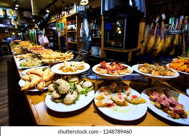 Tasty tapas to pick at the counter top in one of the famous tapas bars of San Sebastian, Basque country, Spain.