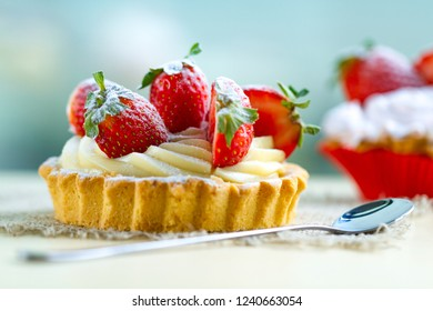 Tasty tartlets with whipped cream and with fresh strawberries. Pastry. Sweet dessert
