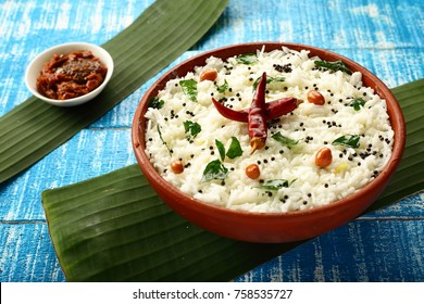 Tasty traditional Indian meal curd rice served with lime pickle.