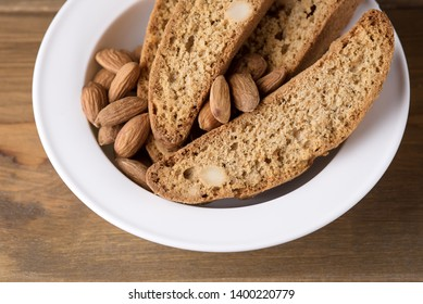 Tasty Traditional Italian Sweets Biscotti or Cantucci on White Plate Wooden Background Italian Biscotti for Coffee or Wine Italian Snack