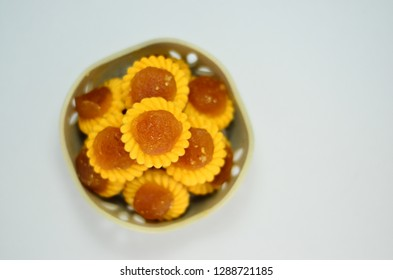 Tasty traditional nyonya pineapple tart cookies in a bowl isolated on a white background