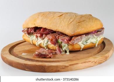 Tasty tuna steak sandwich in a ciabatta with lettuce, onions, Marie Rose sauce and lemon juice