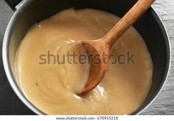 Tasty turkey gravy in saucepan