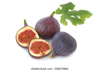 Tasty two figs and slices with leaf isolated on white background