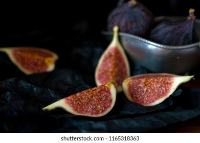 tasty, useful and juicy figs on a dark background in the composition