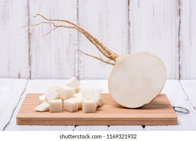 Tasty and useful turnip on white wooden background