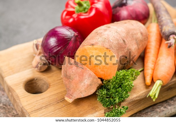 Tasty vegetarian food, colorful ingredients for sweet potato soup, raw and uncooked.