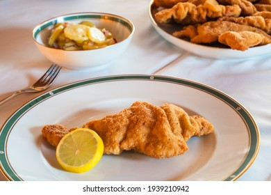 Tasty Viennese Schnitzel or Wiener Schnitzel with a Lemon Wheel and a Side of Potatoe Salad, Traditional Austrian Cuisine