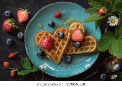 Tasty waffles with berries and honey, Top view