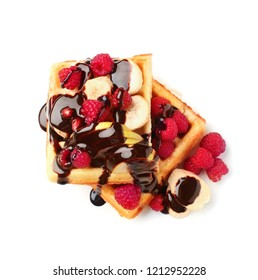 Tasty waffles with fruit, berries and chocolate topping on white background
