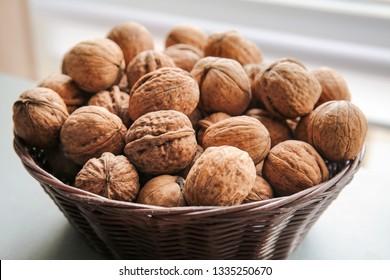 Tasty walnuts in bowl, closeup