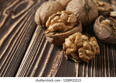 Tasty walnuts on wooden table, closeup