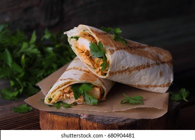 Tasty wraps with grilled chicken meat and fresh parsley