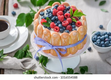Tasty yoghurt cake with raspberries and blueberries served with coffee