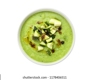 Tasty zucchini soup in bowl on white background