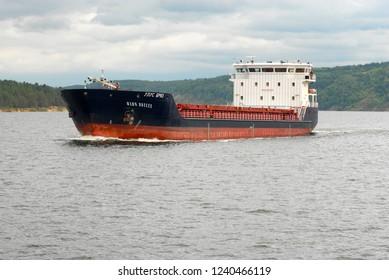 Tatarstan Republic, Volga Region, Russia - September, 2015: Cargo ship is floating up the Volga river.