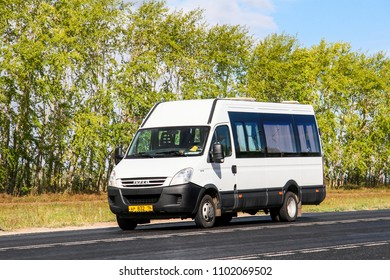 Tatarstan, Russia - August 20, 2011: White passenger van Iveco Daily at the interurban road.