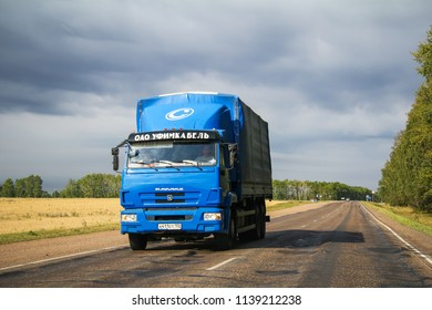 Tatarstan, Russia - August 20, 2011: Blue flatbed truck Kamaz 65117 at the interurban road.