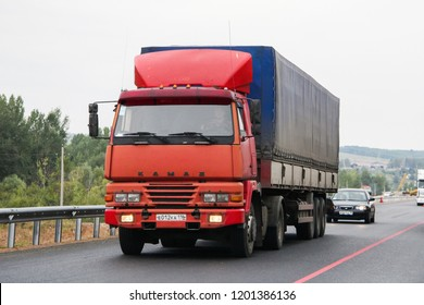 Tatarstan, Russia - August 20, 2011: Red semi-trailer truck Altkam 5443 (Kamaz 5425MA) at the intercity freeway.