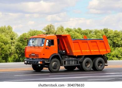TATARSTAN, RUSSIA - AUGUST 27, 2011: Brand new dump truck KamAZ 65115 at the interurban road.
