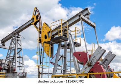 Tatarstan, Russia - June 10, 2018: Working pump jack fracking crude extraction machine. Oil industry equipment