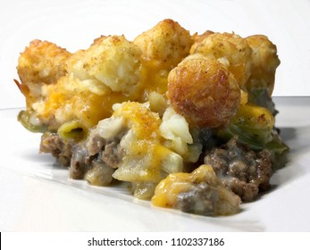 Tater tot hotdish. A truly American baked casserole of layered hamburger, mushroom soup, green beans, cheddar cheese and tater tots.