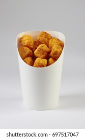 Tater Tots in Carton on White