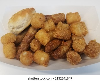 tater tots, turkey sausage, and biscuit in a white container
