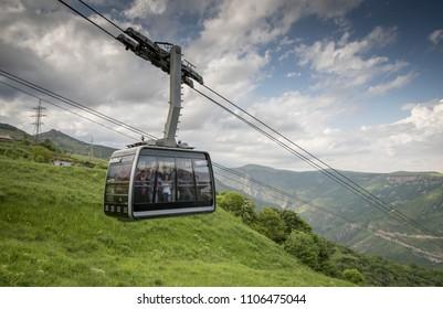 Tatev, Armenia, 1st June, 2018: people traveling in wold's longest reversible cable car in Tatev Armenia