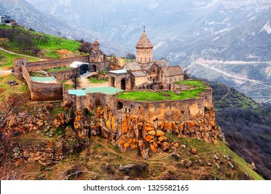 Tatev, Armenia. Aerial view of 9th-century Armenian Apostolic monastery located near the Tatev village in Armenia. Tree and mountains at the background in spring
