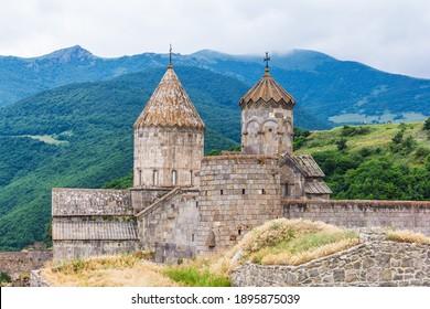 Tatev monastery in Goris , Armenia, a 9th-century Armenian Apostolic monastery. The monastic ensemble stands on the edge of a deep gorge of the Vorotan River.   - Shutterstock ID 1895875039