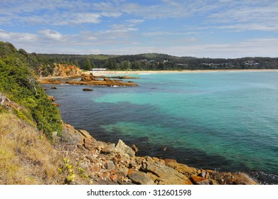 Tathra is a seaside village on the far south coast, called the Sapphire Coast in the Bega Valley shire.  Views from the rocky headland looking back towards Tathra beach.on a beautiful sunny day