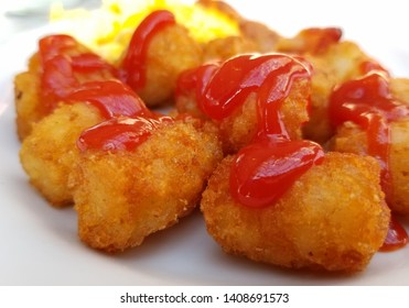 Tator tots covered in ketchup