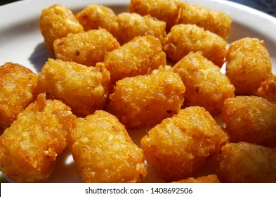 Tator tots on a white plate