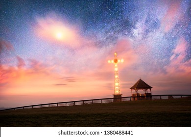 Tatra Mountains - on the top of the mountain stands a beautifully lit cross, a symbol of Christianity. Poland, Zakopane many attractions among beautiful nature