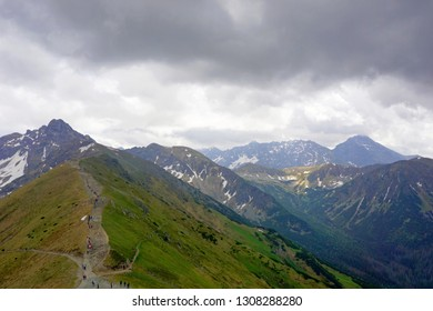 Tatra Mountains, Poland. View from Kasprowy Wierch to Swinica mount, tourists on the trail