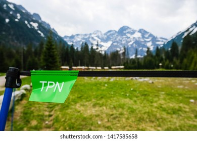 Tatra National Park/ Poland  - 27 may 2019: View on mountains, beautiful valley, forest at national park in Poland. Mountain view of tatra mountains at the background with tpn logo.