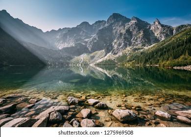 Tatra National Park, Poland. Famous Mountains Lake Morskie Oko Or Sea Eye Lake In Summer Morning. Beautiful Sunrise Sunrays Above Tatras Lake Landscape. UNESCO's World Network of Reserves