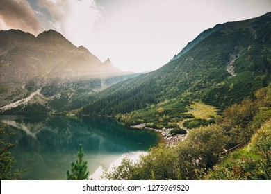 Tatra National Park, Poland. Famous Mountains Lake Morskie Oko Or Sea Eye Lake In Summer Evening. Beautiful Sunset Sunrays Above Tatras Lake Landscape. UNESCO's World Network of Reserves
