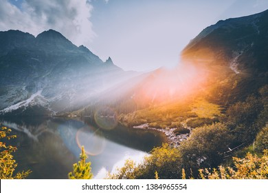 Tatra National Park, Poland. Famous Mountains Lake Morskie Oko Or Sea Eye Lake In Summer Evening. Beautiful Sunset Sun Sunshine Sunbeams Above Tatras Lake Landscape. UNESCO's World Network of Reserves