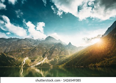 Tatra National Park, Poland. Famous Mountains Lake Morskie Oko Or Sea Eye Lake In Summer Evening. Beautiful Sun Sunset Sunrays Above Tatras Lake Landscape. UNESCO's World Network of Reserves