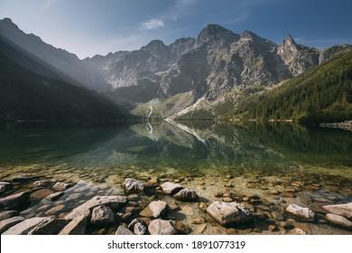 Tatra National Park, Poland. Famous Mountains Lake Morskie Oko Or Sea Eye Lake In Summer Morning Sunrise. Beautiful Sunrays Above Tatras Lake Landscape. UNESCO's World Network of Reserves - Shutterstock ID 1891077319
