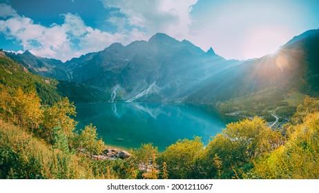 Tatra National Park, Poland. Famous Mountains Lake Morskie Oko Or Sea Eye Lake In Summer Evening. Beautiful Sunset Sun Sunshine Sunrays Above Tatras Lake Landscape. UNESCO's World Network of Reserves