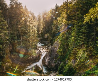 Tatra National Park, Poland. Waterfall Wodogrzmoty Mickiewicza In Summer Mountains Sunset Landscape. Sunlight Through Trees In Tatras. European Nature. UNESCO's World Network Of Biosphere Reserves