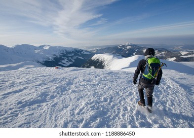 TATRY MOUNTAINS, POLAND - MARCH 3, 2017 : Hiker walkin on the summit one of the Western Tatra.